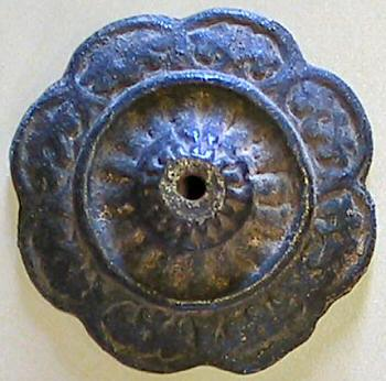 rosette with dark bronze patina