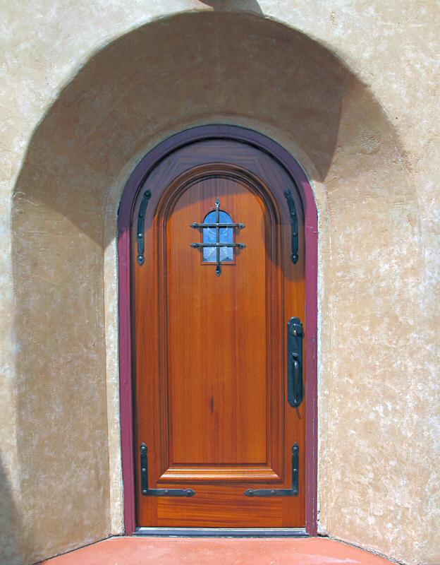 Mahogany entry with wrought iron